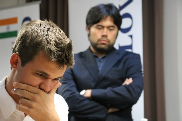 Nakamura peering at the Carlsen's game against MVL. Photo by chess.com.