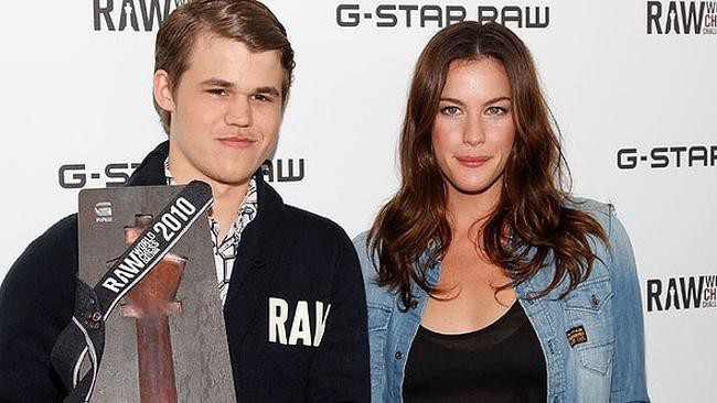 Carlsen with Liv Tyler promoting fashion brand G-Star Raw. Picture: Getty Images
