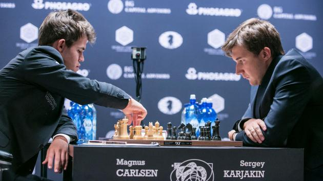 Carlsen Fights Off Karjakin To Draw Again As White