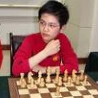 hou yifan becomes GM, breaks record