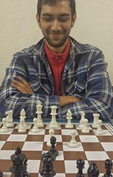 Taha Ansari visits Musselburgh chess club to play Jim Crawford