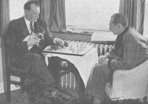 Alexander Alekhine plays chess with cat