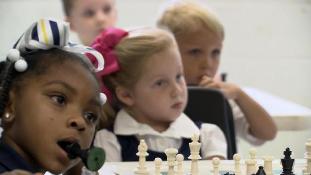 "Why chess kids put on a ""poker face"""