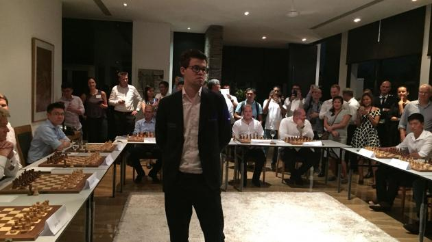 Magnus Carlsen's Singapore Simultaneous Exhibition - an astounding show of speed and precision!