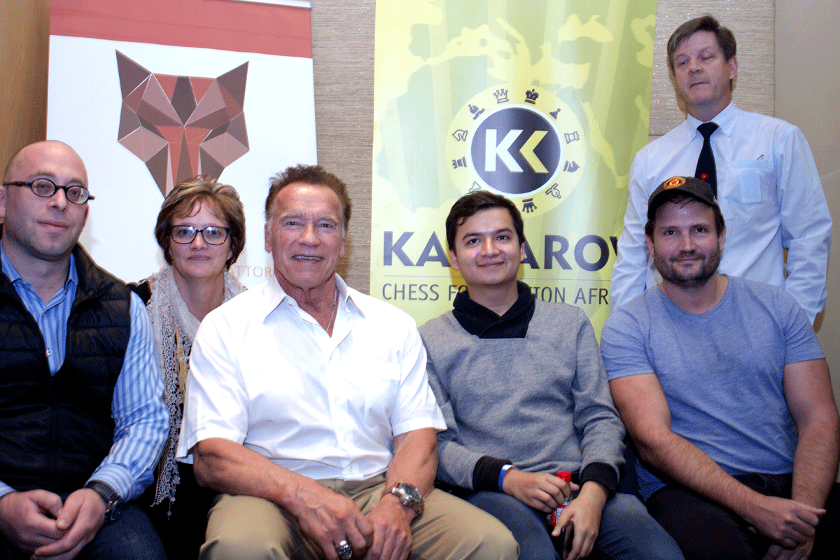 Arnold Shwarzenegger with GM Grover Sahaj and Chess South Africa officials. | Photo: Alessandro Parodi/Chess.com