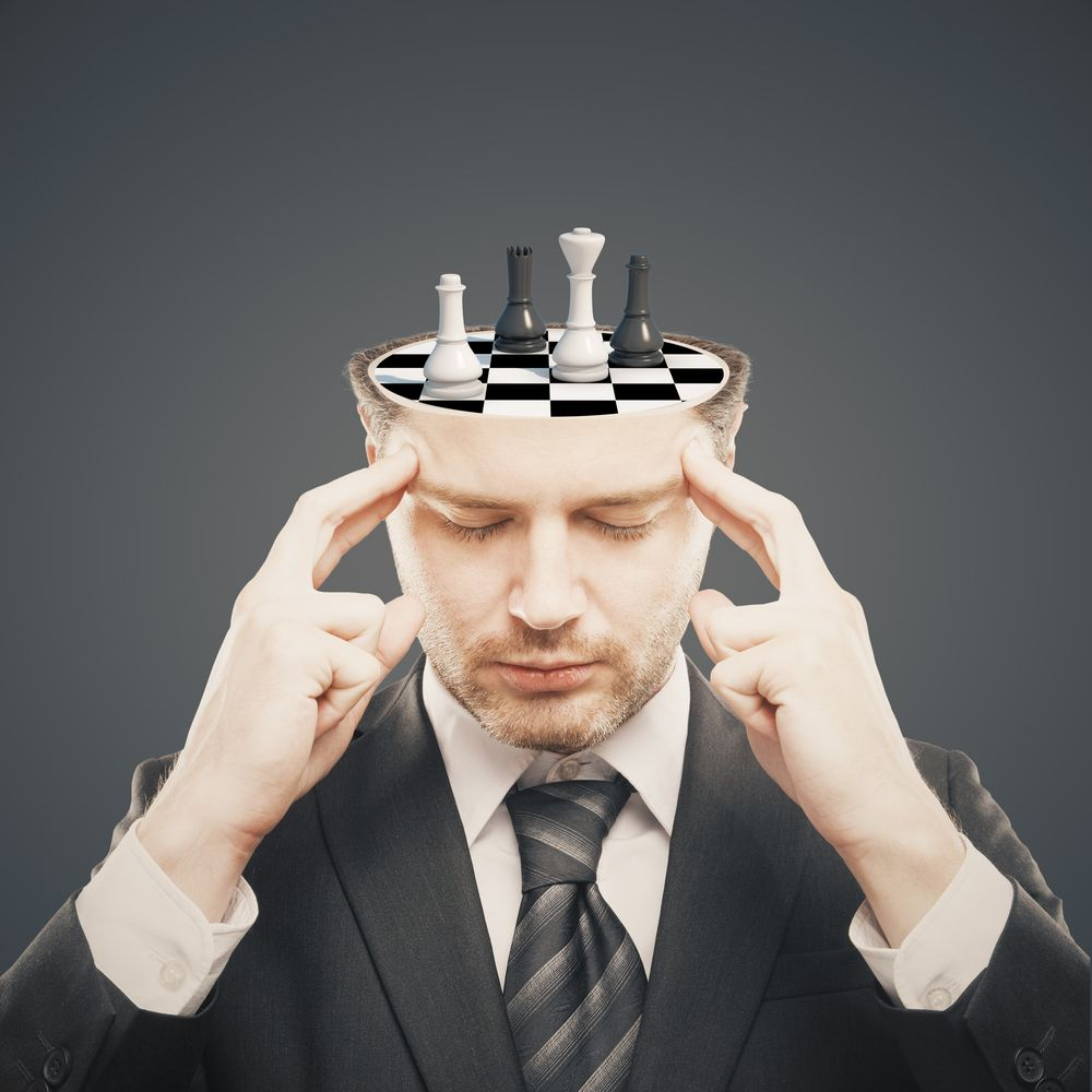 man with chess on head