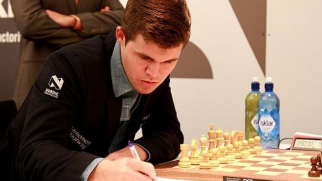 Carlsen Beats Adams, Leads Grenke After Round 2