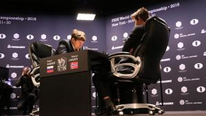 Carlsen Escapes, Draws Karjakin In Game 9's Thumbnail