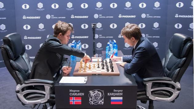 Carlsen Wins Marathon Game To Even Match With Karjakin