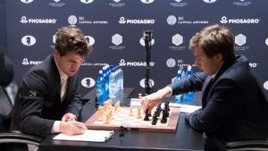Carlsen, Karjakin Draw Game 12; Playoffs Wednesday's Thumbnail
