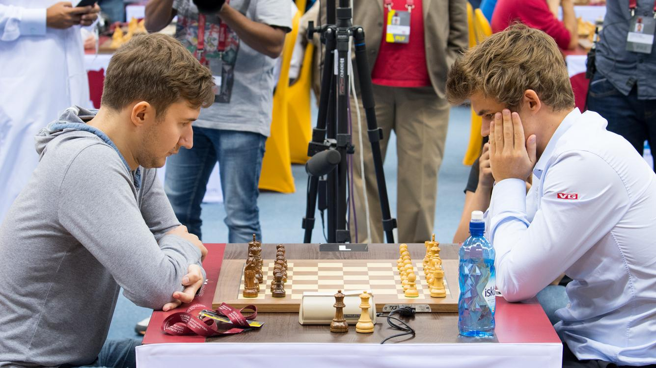 Carlsen, Karjakin Lead World Blitz Champs At Half