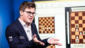 Иконка Карлсен выигрывает парижский рапид и спорит с журналистом