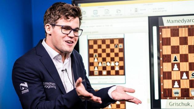 Carlsen Em Primeiro Lugar nas Rápidas em Paris, Irritado na Entrevista
