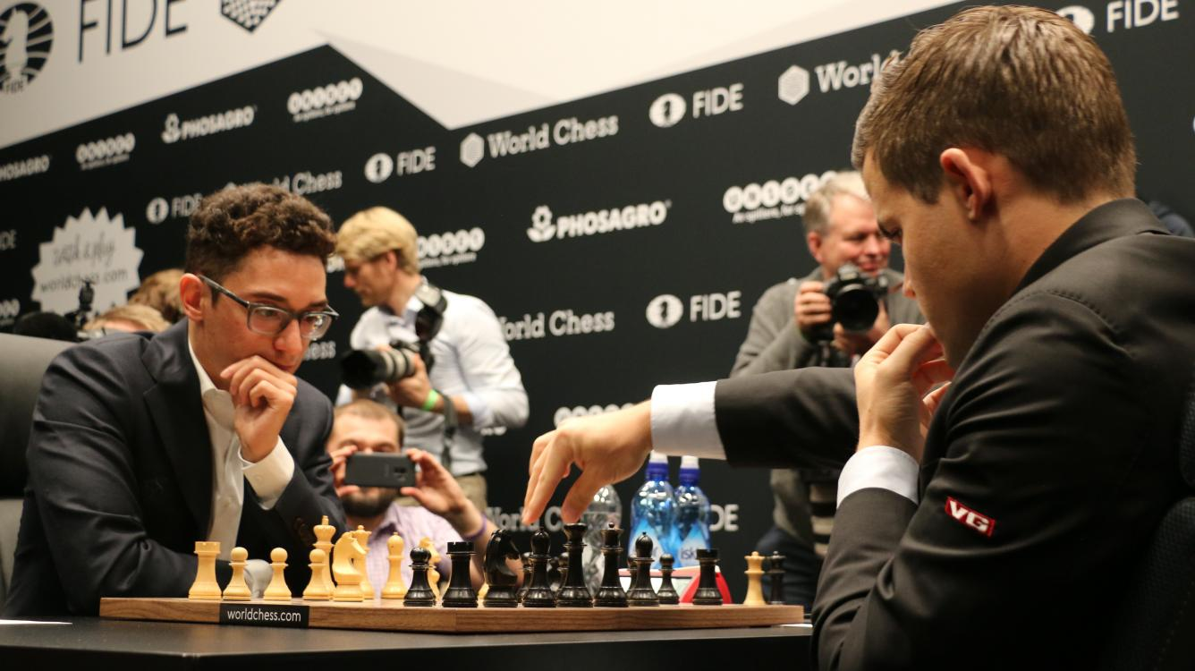World Chess Championship Game 1: Caruana Struggles But Holds Draw Against Carlsen